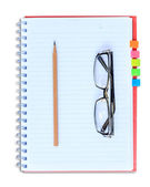 Red notebook pencil — Stock Photo