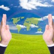 Green world map in business man hand — Stock Photo #6777069