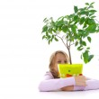 Schoolgirl and the tangerine tree in the green pot — Stock Photo #12620741