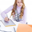 The schoolgirl painting with the digitizer and netbook — Stock Photo