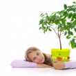 Schoolgirl and the tangerine tree in the green pot — Stock Photo