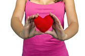 A red heart in hands — Stockfoto