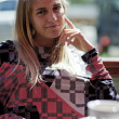 Stock Photo: Pretty blond girl sitting in a cafe