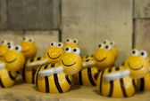 Many yellow ceramic bees looking at you — Foto Stock