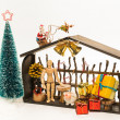 Stock Photo: Wooden Christmas shop with Santand raindeer isolated on white background