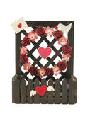 Fence of flower and heart symbol isolated on white background — Stock Photo