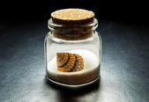 Beautiful sea shell on white sand in transparency bottle — Stock Photo