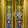 Decoration of Thai temple door with carving and painting — Stock Photo