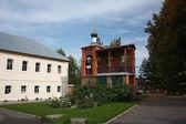 Pokrov. Vvedensky island hermitage (monastery). Cells and the monastery belfry. — Stock Photo