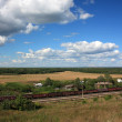 Rural landscape with a railroad train. Russia — Stock Photo