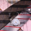 Stock Photo: Multicolored ties, vintage watches and glasses