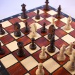 Stock Photo: Chess game. Chess pieces on a chessboard