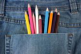 Colored pencils lay in a pocket — Stock Photo