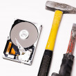 Stock Photo: Hard disk and repair tools