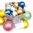 Gift bag and Christmas balls around — Stock Photo