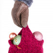Stock Photo: Hand holding knitted hat with Christmas decorations