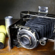 Stock Photo: Antique bellows camerand original film