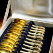 Stock Photo: Box of vintage gold-plated teaspoons
