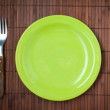 Empty dinner plate, knife and fork. — Stock Photo