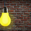 Yellow light bulb. — Stock Photo