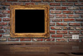 Golden frame on the wall. — Stock Photo