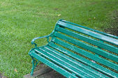 Green chair in the garden — Stock Photo