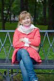 Cheerful girl walking in autumn park — Stock Photo