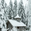 Stock Photo: Wooden chapel in snowy forest. Winter north.