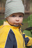 Little boy playing in the park. Early spring. — Stock Photo