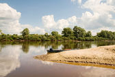 Boat sandy beach on the forest river — Stock Photo