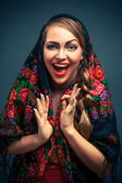Happy woman in a headscarf in the Russian style. — Stock Photo