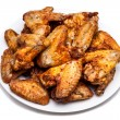 Plate of delicious barbecue chicken wings — Stock Photo #27506173
