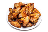 Plate of delicious barbecue chicken wings — Stock Photo