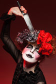 Woman mime with knife — Stock Photo