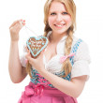 Bavarian woman in dirndl, holding lebkuchen. — Stock Photo #33442153