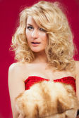 Blonde woman in red dress — Stock Photo