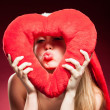 Young beautiful woman with big red heart — Stock Photo #39333779