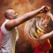 Young couple dances Caribbean Salsa — Stock Photo