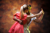 Young couple dances Caribbean Salsa — Stock Photo