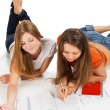 Two young happy student girl work on laptop — Stock Photo #49835757