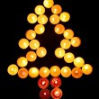 Christmas tree of candles — Stock Photo