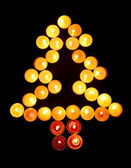 Christmas tree of candles — Stok fotoğraf