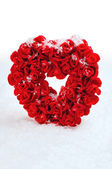 Red stone heart in artificial snow — Stock Photo