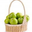 Fresh green apples in a basket isolated on a white background — Stock Photo