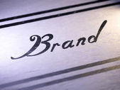 """Brand"" on paper — Stock Photo"