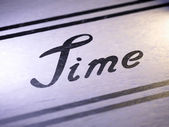 """time"" on paper — Stock Photo"