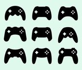 Gamepads silhouettes — Stock Vector