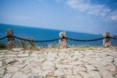 Stone road near the sea — Stock Photo