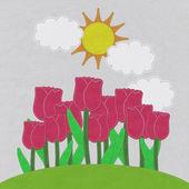 Lale dikiş tarzı kumaş arka plan ile yeşil çim sahada — Stok fotoğraf