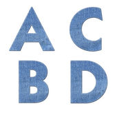 Alphabet with stitch design elements on denim texture — Foto de Stock
